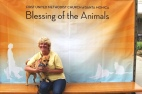 Volunteer Karen Hopkins and her Sammy at the annual Blessing of the Animals 2015