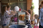 Youth serving cotton candy from Fall Kick Off 2015