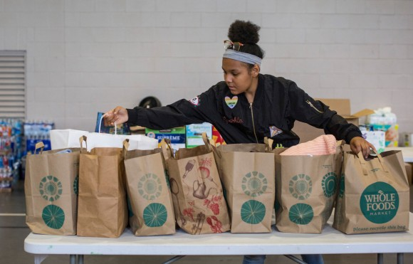Zamora Contreras, age 13, helps sort items for folks in need following flooding from Hurricane Harvey. She's a member of Westbury United Methodist Church in Houston, and the church has found various ways to serve Harvey flood victims. Photo by Kathleen Barry, UMNS
